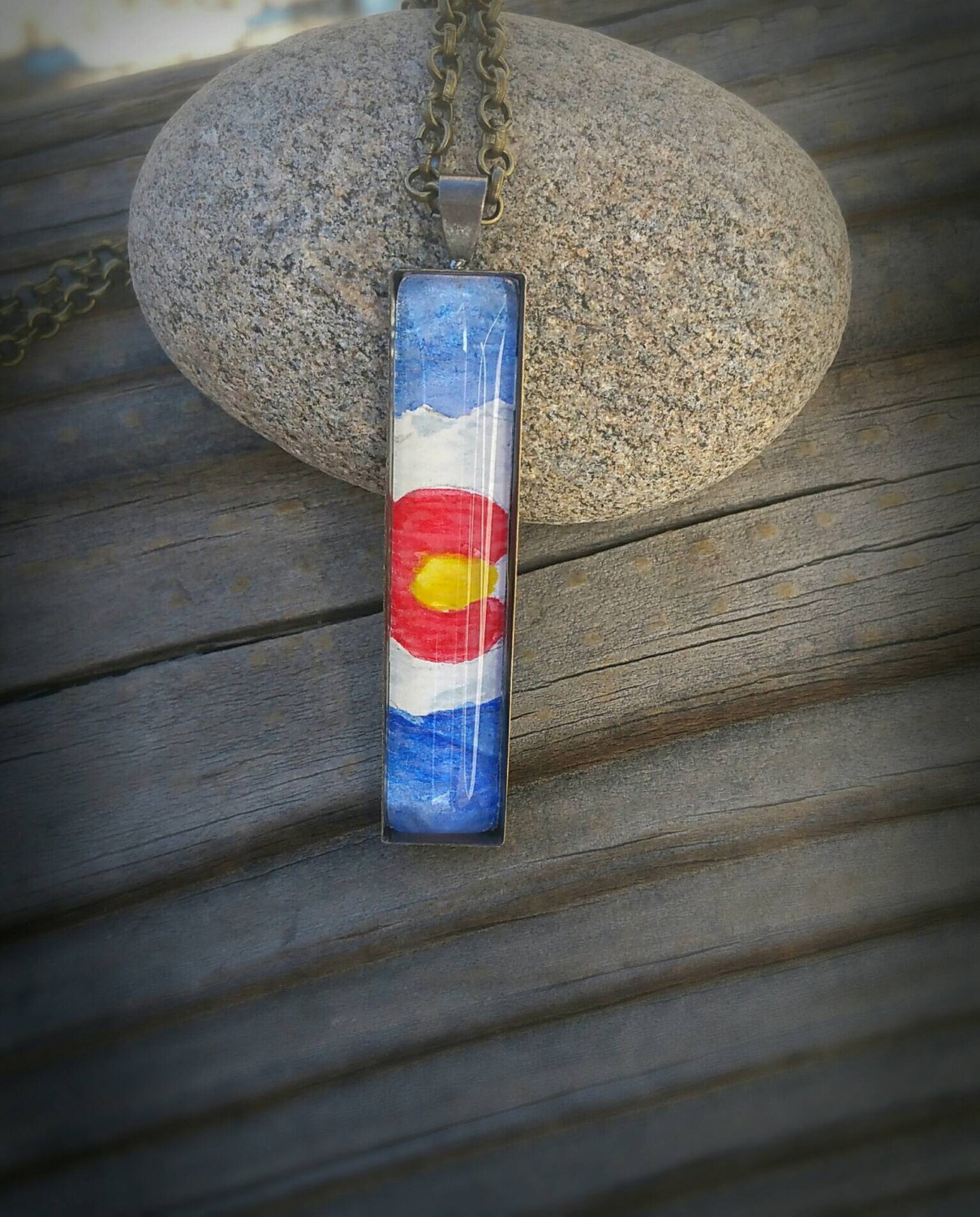 Colorado necklace. Colorado flag with mountains hand painted in watercolor, under glass in antiqued brass/bronze setting. Colorado jewelry