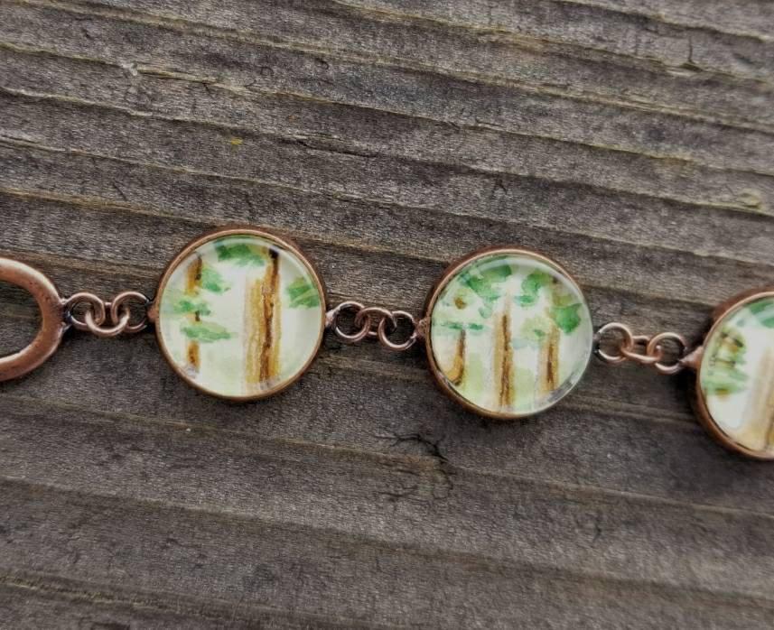 Bigfoot bracelet. Bigfoot jewelry, sasquatch bracelet, hand painted, watercolor mini paintings in an antiqued copper setting.  Bigfoot gift