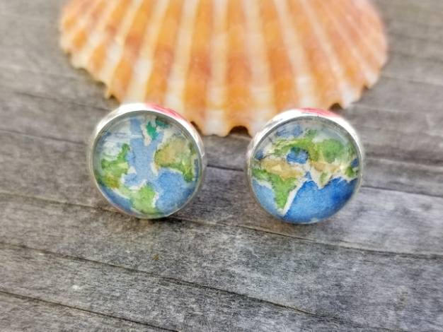 Earth earrings.  Globe earrings. Hand-painted watercolor miniature paintings of two views of the globe in silver-plated stud earrings