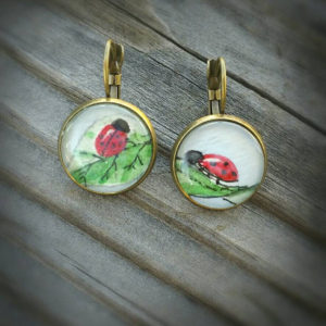 Ladybug earrings.  Ladybird beetles, hand painted in watercolor and ink,  antiqued bronze lever-back earrings, red with green leaves